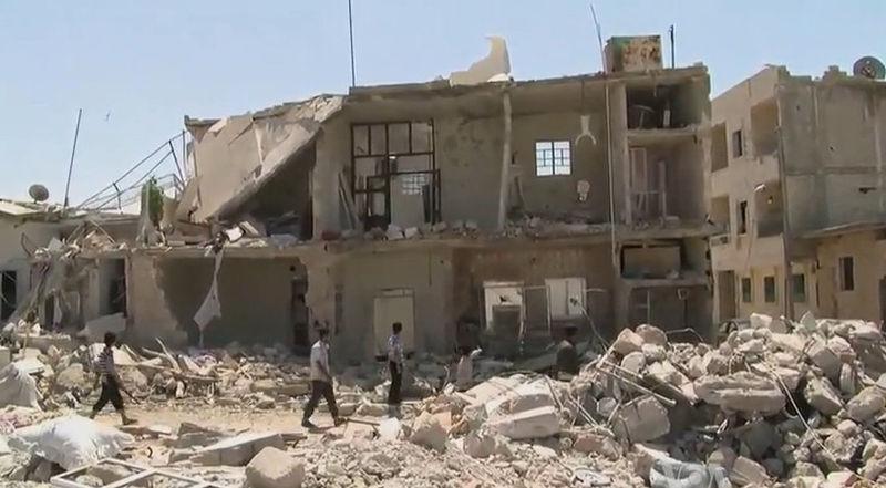 Zerstörte Gebäude in Azaz in Syrien im August 2012 (Quelle: Voice of America News/Wikimedia)